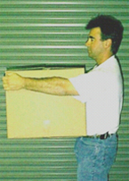 A man carrying a box of wiping cloths